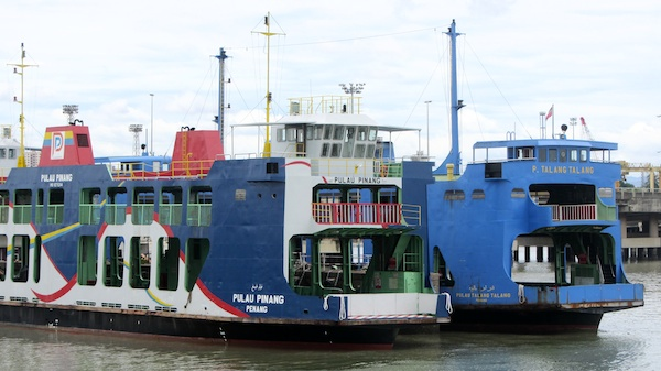Colourful Penang car ferries lined up at the dock