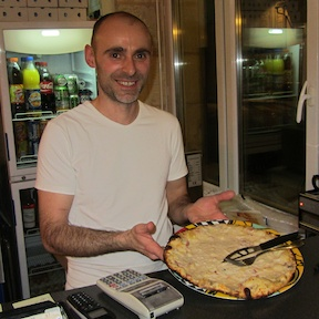 Stephan and his solution to gluten-free pizza, after I'd finished eating it.