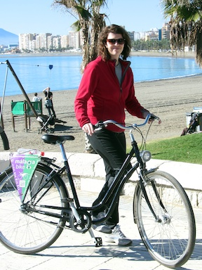 Girl on bike. Malaga is in the background.