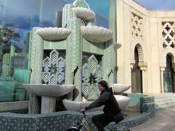 Bronwyn cycles past the Moorish Pavilion, now used as a store room.