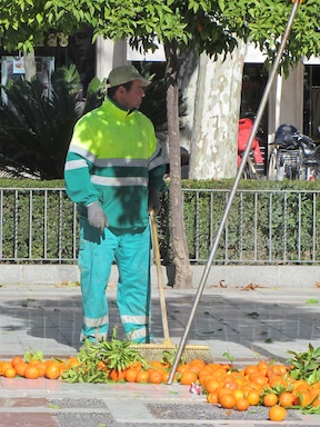 Sweeping up the damn oranges