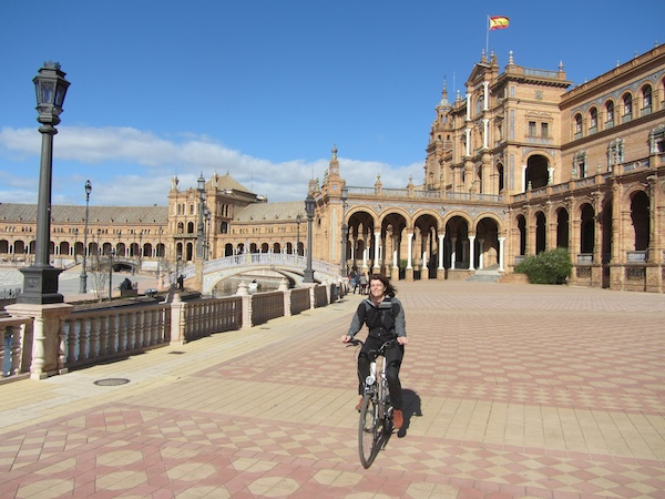 Bronwyn cycles across La Place d'Espana