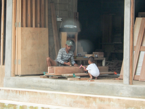 Woodworker teaching his son in Ubud