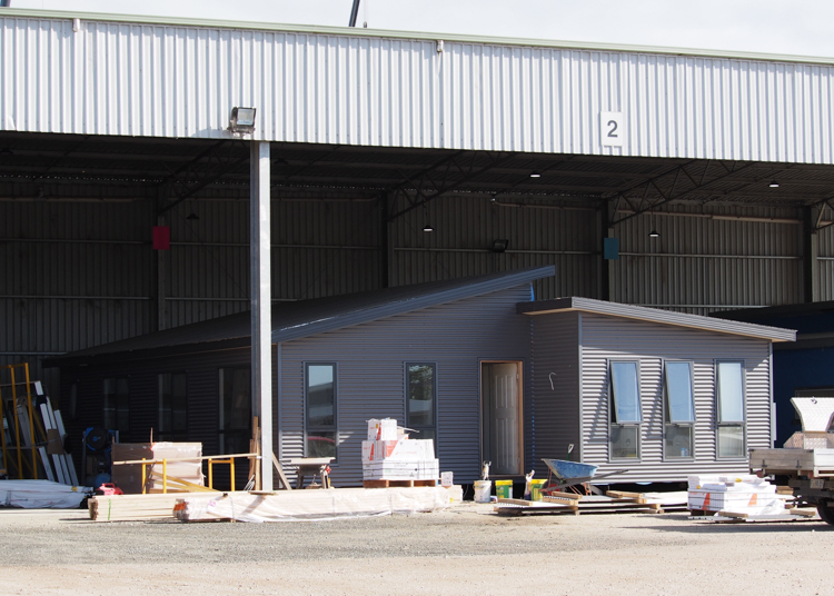 TasBuiltHomes factory with a prefabricated house inside
