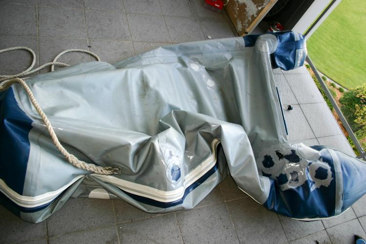 Crushed and deflated Zodiac tender